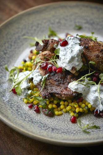 Spice crusted chicken on Israeli cous cous with herbed yoghurt