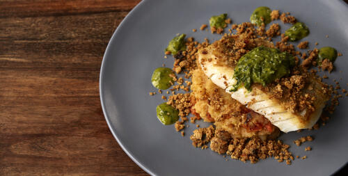 Roasted cod on sun dried tomato potatoes with salsa verde
