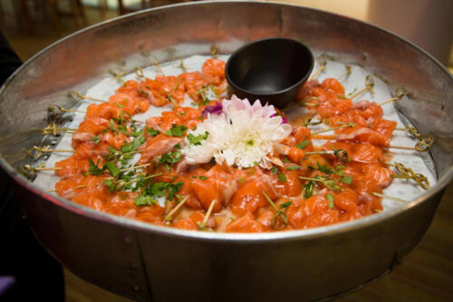 Salmon sashimi with a blood orange sauce